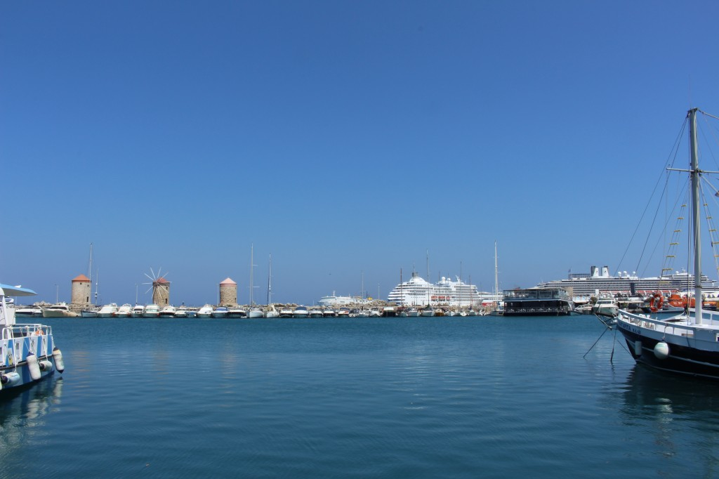 Windmills and cruise ships at the Mandraki harbour in Rhodes.