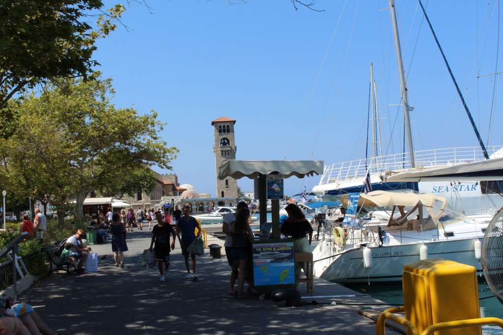 Stands offering tours at Mandraki Harbour in Rhodes.