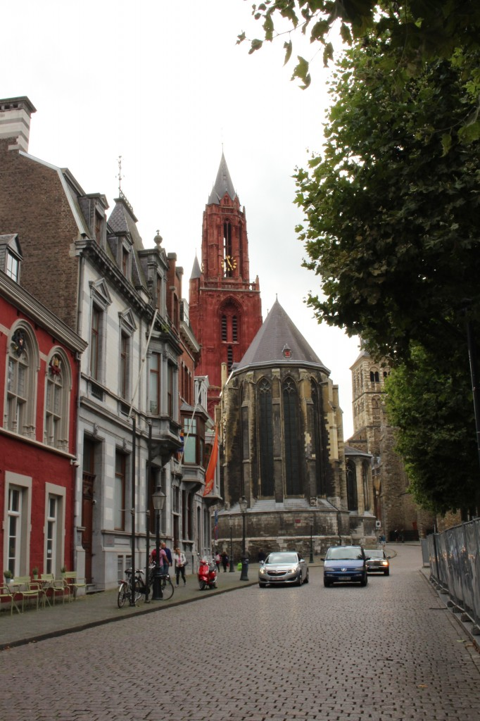 The red tower of the Sin Jans Kerk in the distance with the Basilica on the right